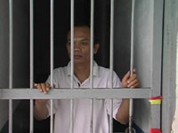 Rev. Rinaldy Damanik behind bars